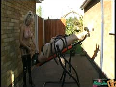 MILF Plays With Restrained Slave Outside