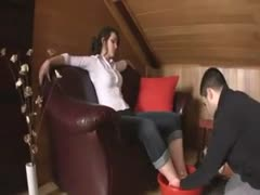 Foot dominant wife having her husband clean her feet