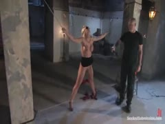 Busty blond girl submits to punishment and anal bondage sex.