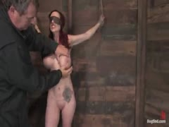 Red head with massive breasts tied up and abused hard.