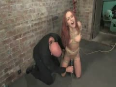 Shaved red head, gets severely bound, and forced to cum. Hogtied.