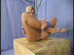 Big--boobed girl tied up and put on display.