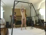 Alana tied up and waiting in the living room