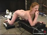 Red-head newbie gets wet with the water machines.