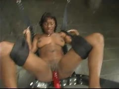 Sexy black girl spreads for a hot machine fucking.