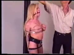 Blonde gagged and bound in bondage