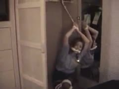 locked gagged and hung from a closet door
