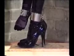 gagged and handcuffed to her ankles