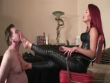 Redhead Smokes Cigarette While Slave Mouth Washes Her Feet