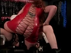 Mean girl in latex takes a weakling to a  personal tight bondage
