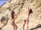 Domme Whips Beach Whore