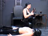 Mistress in tight latex ass spanking her slave