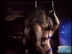 Helpless tied brunette gets played by a BDSM couple