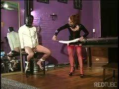 Femdom latex bitch torturing his swollen balls