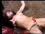 Evil women performing sadistic acts on unwilling bound girl