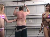 Bikini babes in bull whips punishing a bound man