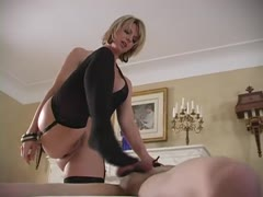 Busty blonde sadistic mistress busting a poor man's nuts