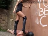 Merciless Mistress uses her high heel boots to torture slave