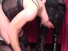 Dame forces a slave to lick his own cum