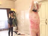 Asian Mistress Natsui relentlessly whips a helpless man