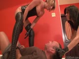 Unmerciful ladies in tight latex punishing a helpless man