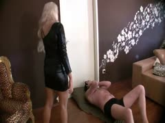 Cruel blonde babe tramples a submissive sissy man