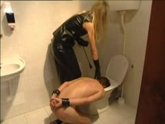 Latex bound blonde in sunglasses punishing a slave