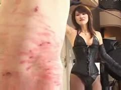 Asian femdom fetish leaving bloody whip marks to slave's body