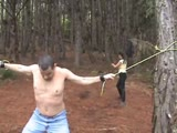 Man bound in a tree and receive severe whipping