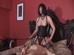 Femdom brunette in sexy lingerie facesits slave in bed