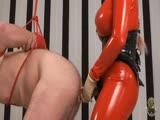 Latex fitted mistress exploring slaves ass