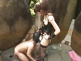 Asian bitch with strapon humiliating outside