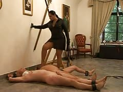 Superior woman giving punishment to her two slaves