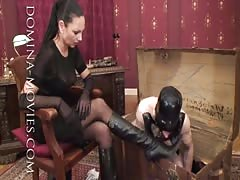 Keeping mistress black boots in shine