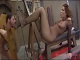 Fascinating brunette with immobilized foot slave