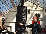 Baroness Bijou plays with her hanging wrapped slave