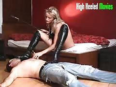 She control her slave with black high heel boots