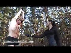 Madame Catrina whipping her victim in the forest