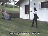 Whipping torture to a tied man in the tree
