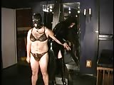 Restrained slave in bikini tormented