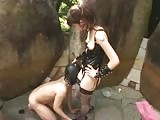 Pegging session outdoors from an Asian domme