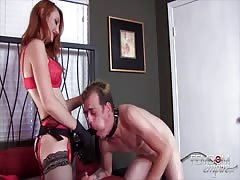Red head dominatrix fucks a guy with her strapon