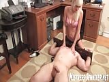 Blonde slender mistress gets rough and kinky with slave in her office