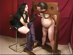 Restrained slave with small cock tortured