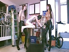 Double pegged by two half naked dominatrix