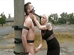 Angry blonde pegging punishment outside