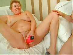 Horny granny's satisfying sexual dreams using strapon