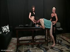 Strapon pegging by cruel mistresses in the dungeon