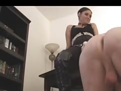Mistress using strapon to humiliate slave